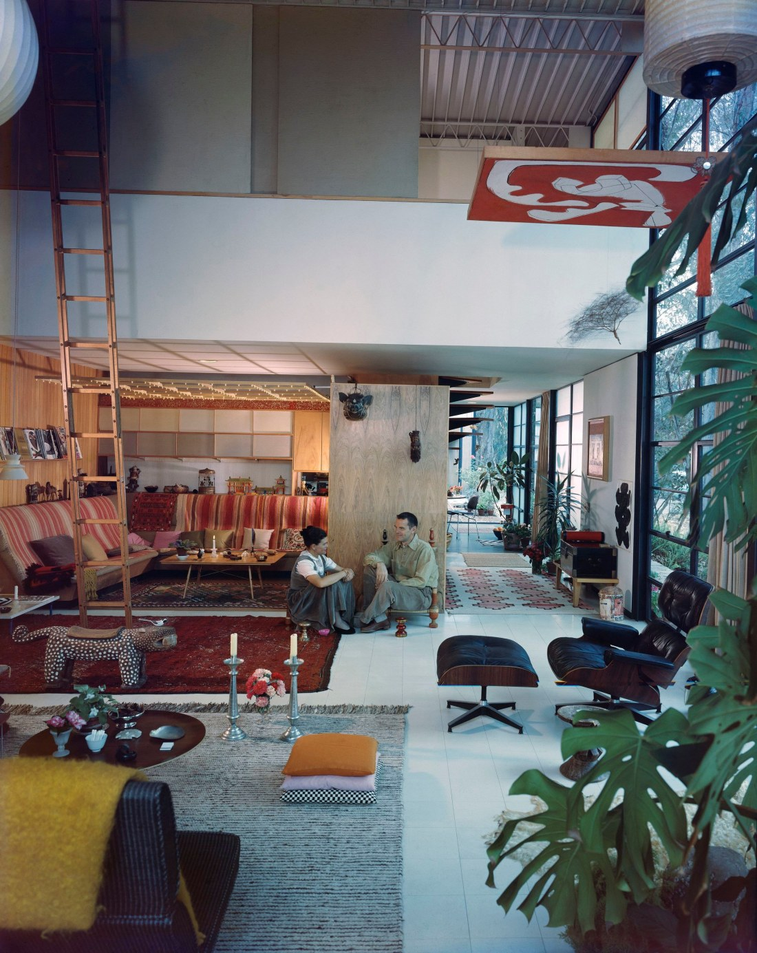 06. An Eames Celebration. Charles and Ray in the living room of the Eames House, 1958